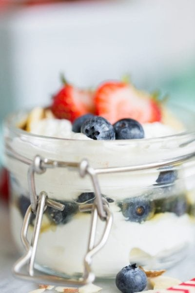 yogurt with berries on top in mason jar