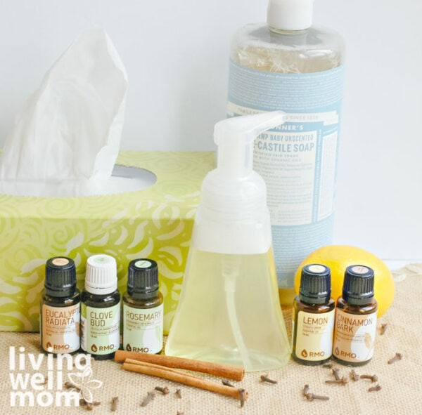 DIY foaming hand soap next to a box of tissues and some essential oils
