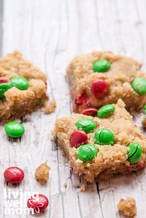 Cookie bars filled with caramel and green and red m&m's.