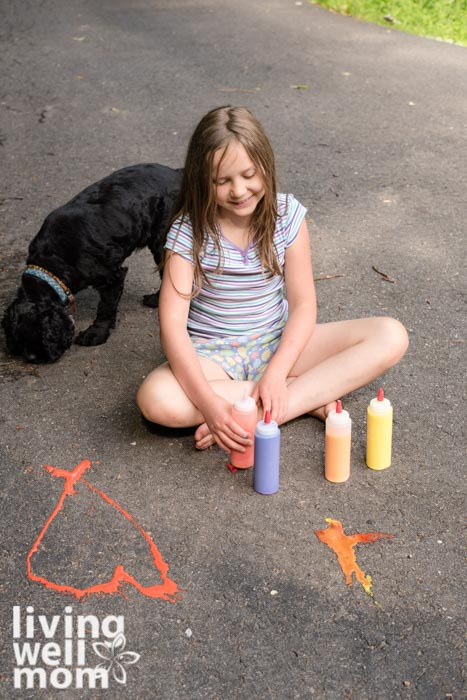 Young girl painting with homemade chalk paint