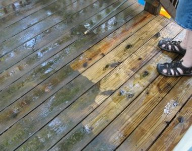 a dirty deck being cleaned
