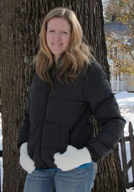 Erika Bragdon posing in a winter coat