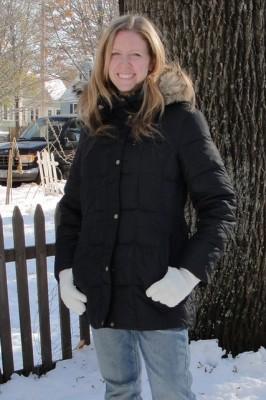woman wearing black winter coat with fuzzy hood