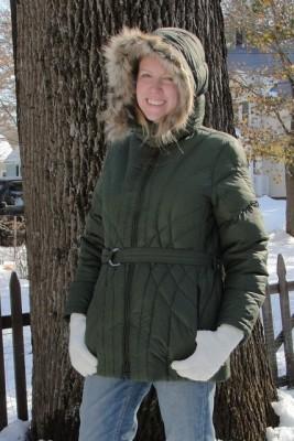 woman wearing green winter coat with fuzzy hood