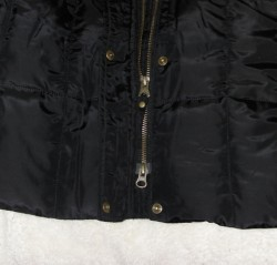 zipper of black winter coat