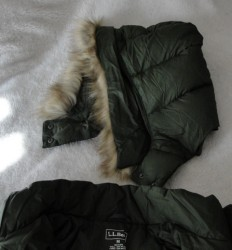 top part of green winter coat with removable fuzzy hood
