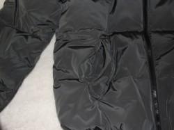 zipper of plain black winter coat