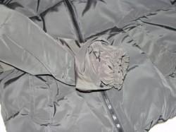 a sleeve of a plain back winter coat
