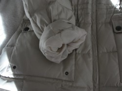 sleeve and pocket of white winter coat