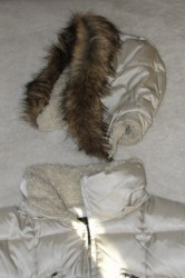 top part of white winter coat with removable fuzzy hood
