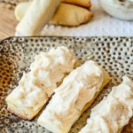 eggnog cookies with white frosting on decorative plate