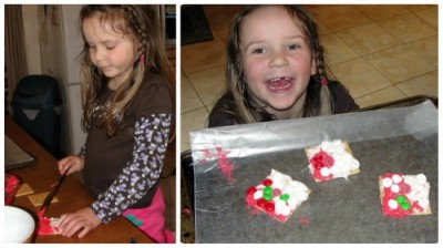 a little girl who is making Santa gram crackers