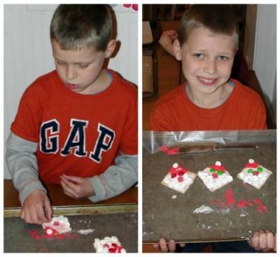 a little boy making Santa gram crackers