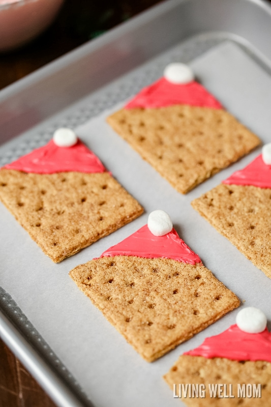 square gram crackers with red frosting on it and a marshmallow