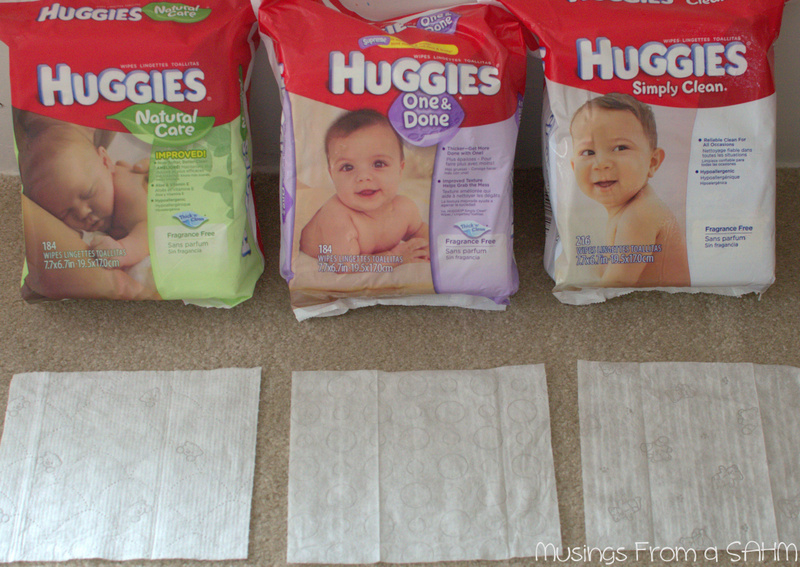 huggies wipes bags with wipes laid out on carpet for comparison