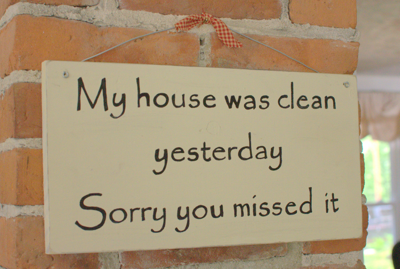 cream colored sign on brick chimney that says my house was clean yesterday sorry you missed it