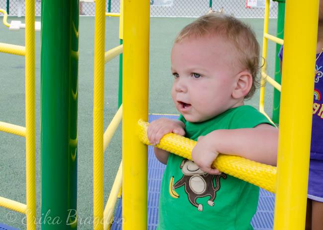 a little boy trying to climb up a ladder