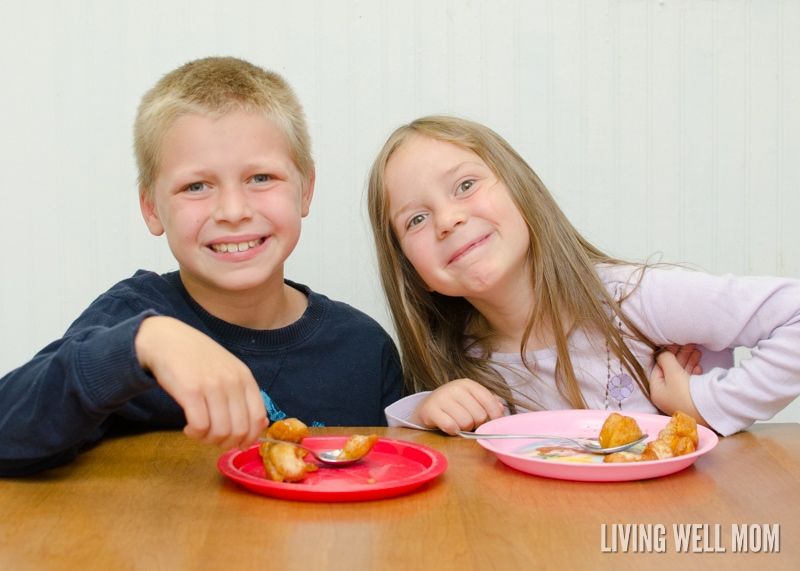 a little boy and girl eating apple monkey bread bites