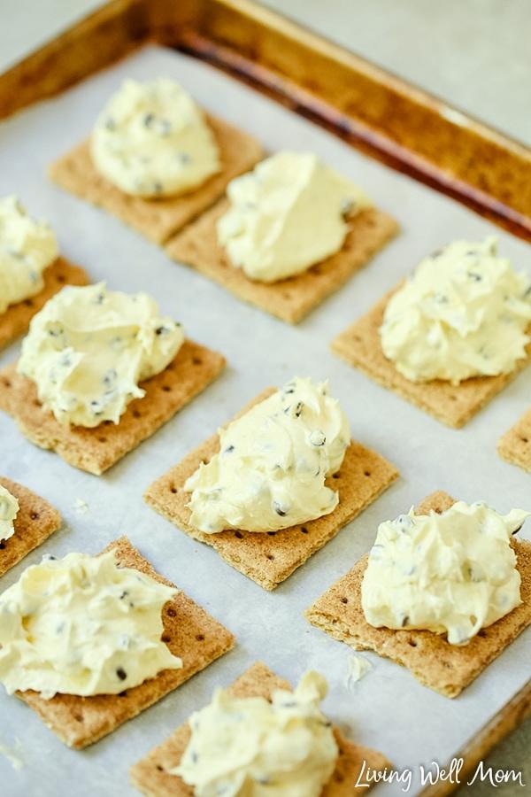 adding ice cream filling to frozen graham cracker treat