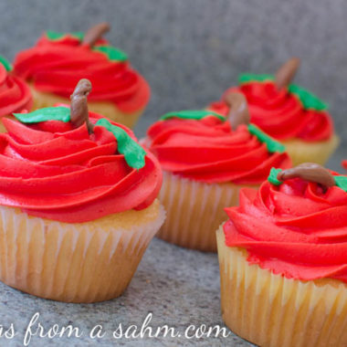 a close up of cupcakes that look like apples