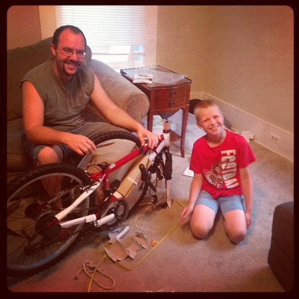 a man putting together  a bike