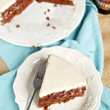 """This easy-to-make Chocolate Root Beer Float Cake has all the flavors of your favorite sweet drink in a delicious chocolate cake! It's perfectly flavored with root beer while the creamy frosting adds the perfect """"foamy' touch. It's really no surprise that this chocolate cake is a family favorite recipe!"""
