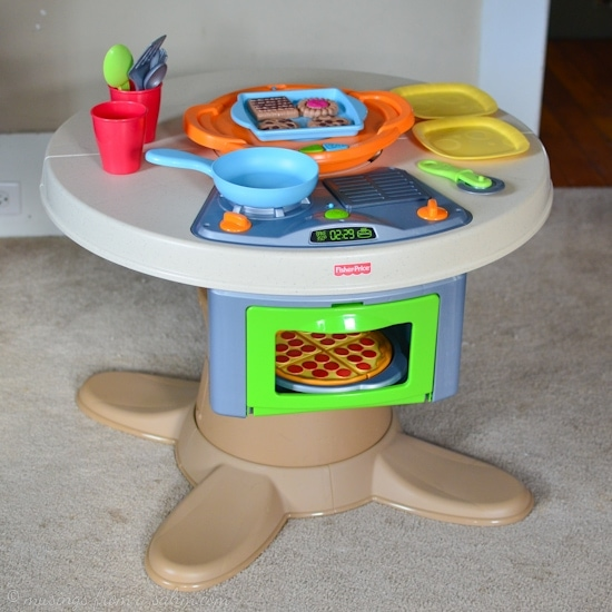 Fisher Price Servin 39 Surprises Kitchen Table Living Well Mom