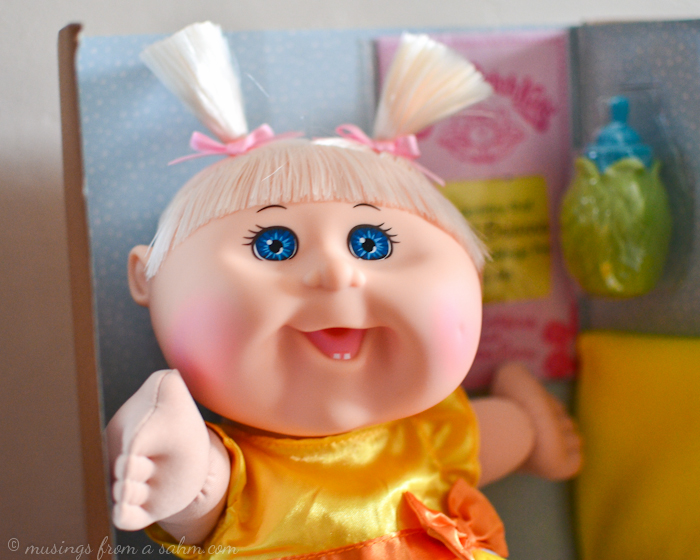 A close up of a cabbage Patch Kids doll