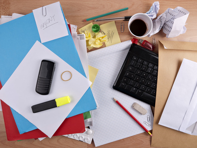 Untidy, messy desk - overwork concept