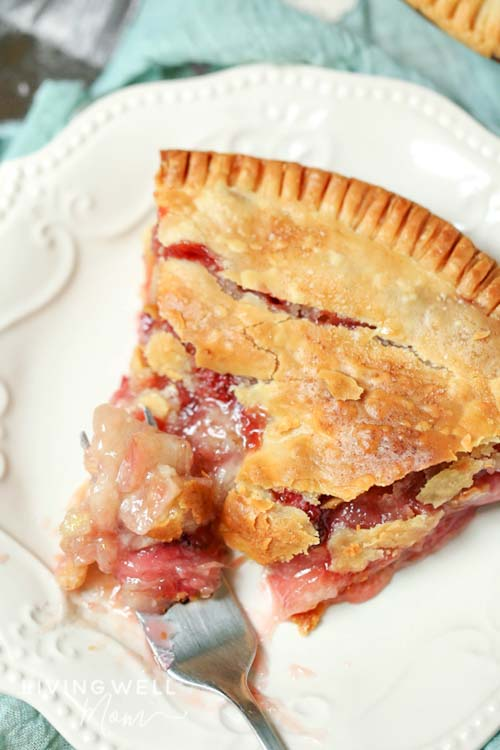 strawberry rhubarb pie on a plate with a fork