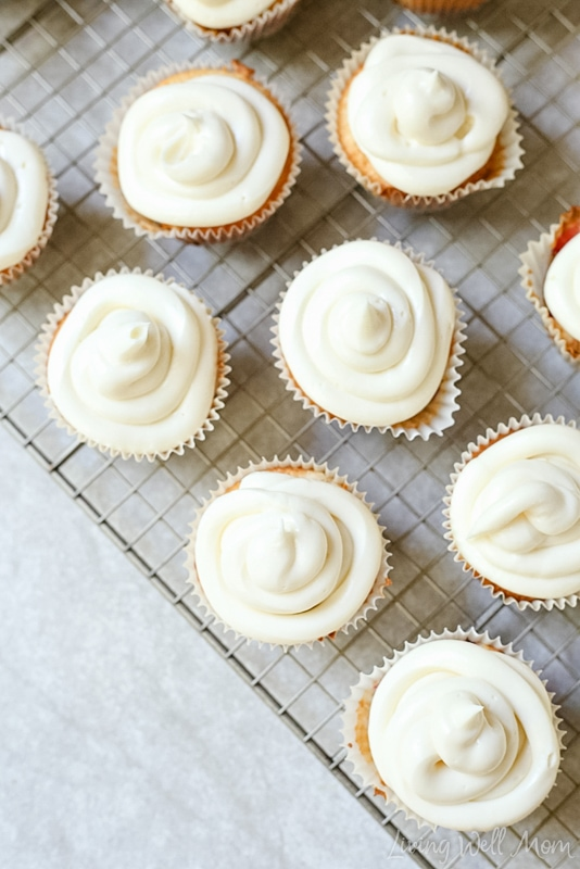 Freshly baked cupcakes topped with a swirl of cheesecake icing.