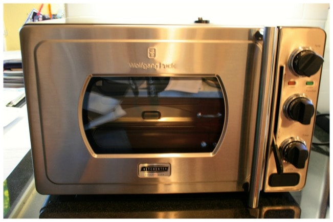 Wolfgang puck pressure oven less cooking more time with for Wolfgang puck pressure oven