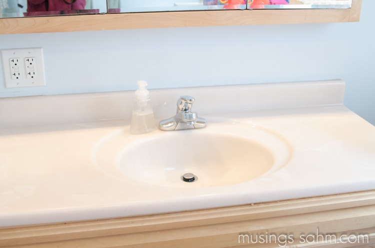 Organizing Toothbrushes & Toothpaste Out of Sight - clear bathroom counter