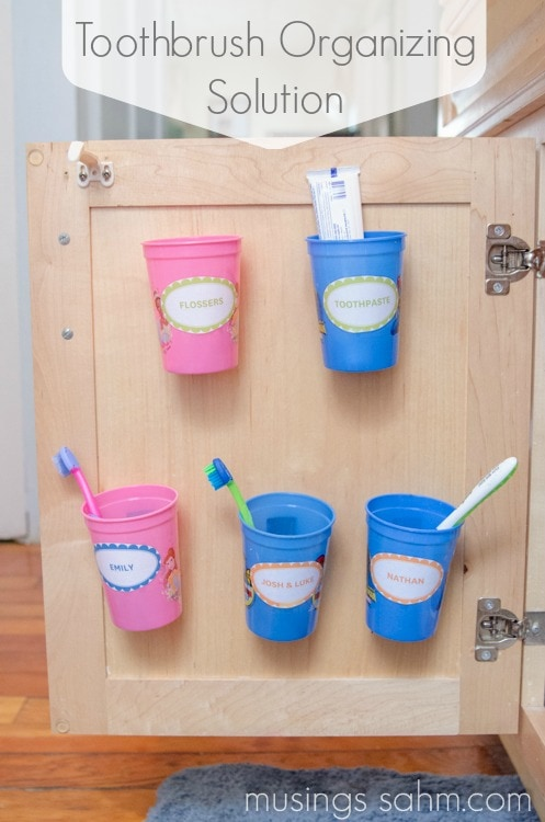 Organizing Toothbrushes & Toothpaste Out of Sigh - handy organization idea costs only a few dollars and will keep the kids' toothbrushes hidden away!