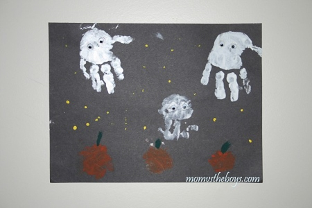 halloween ghost art made out of handprints