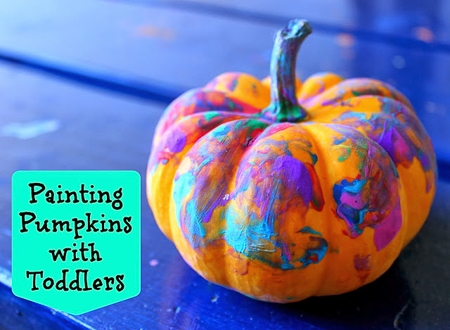 toddler painted pumpkin as a halloween arts and crafts project