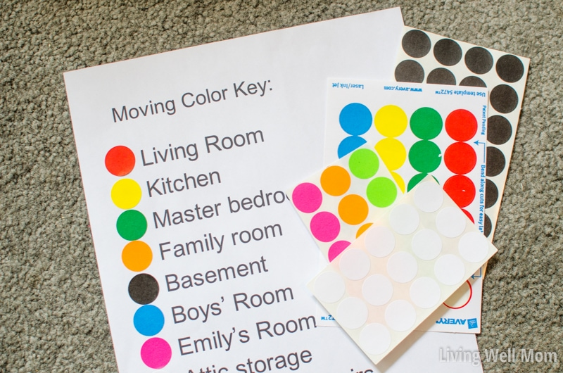 Colored stickers next to each room on a list of rooms in a house, for color coding moving boxes.