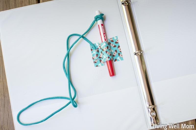 dry erase expo marker holder attached in kids binder