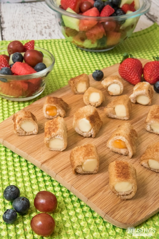 """Grilled Cheese """"Sushi"""" Rolls are a delightful cheesy twist on the classic sandwich that both kids and adults love. They're fairly simple to make and are great for lunch or snack or even a fun dinner - the kids won't mind!"""