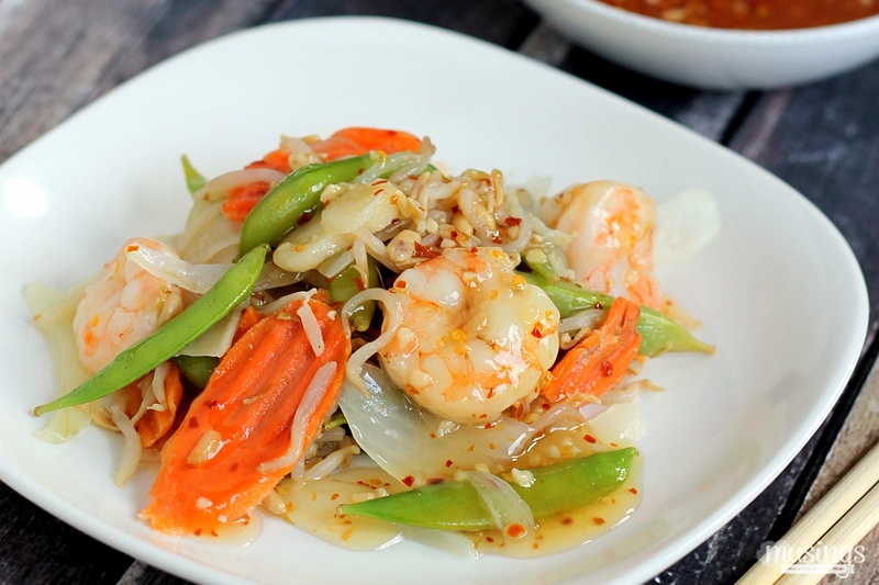 Treat yourself to this tasty Sweet Chili Asian Shrimp Stir Fry recipe for a quick and easy, healthy dinner. You'll love the flavorful honey sauce (there's no sugar!) combined with vegetables and shrimp. Yum!