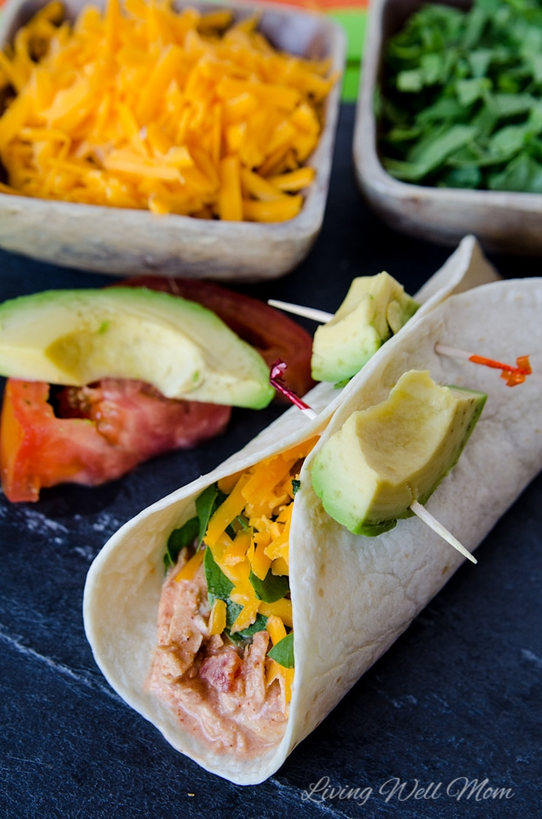 This Slow Cooker Chicken Tacos recipe is unbelievably easy to make and it's so delicious, it will quickly become a favorite family dinner.