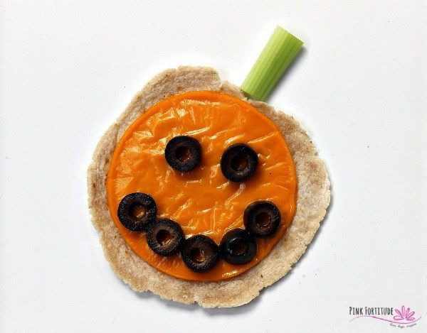 halloween pumpkin tortillas with olives and celery