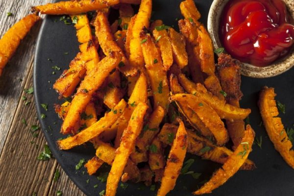 oil free pumpkin french fries on a plate with ketchup dipping sauce