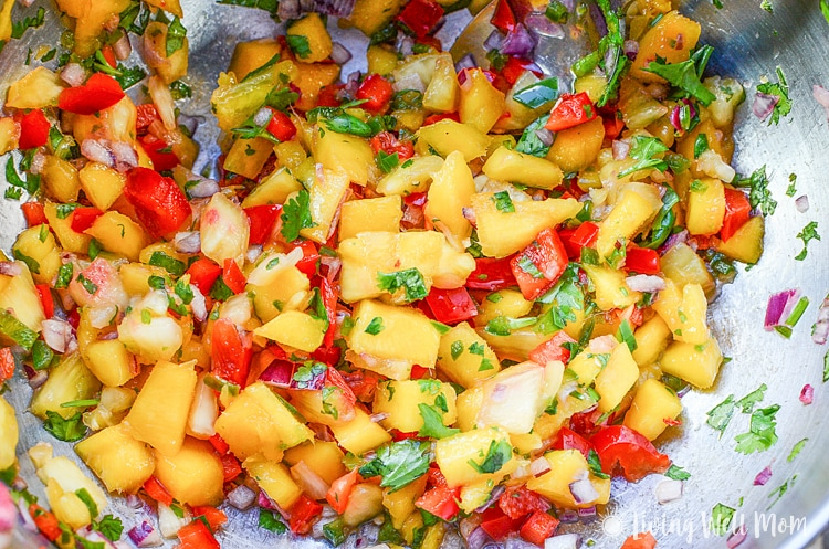 With simple, wholesome ingredients, this recipe for Coconut Crusted Salmon with Mango Pineapple Salsa will transport you to a tropical getaway, even though it's simple enough to make on a busy weeknight. | Paleo friendly