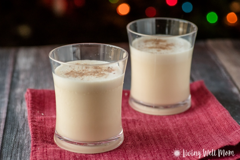 2 cups of eggnog in front of a christmas tree