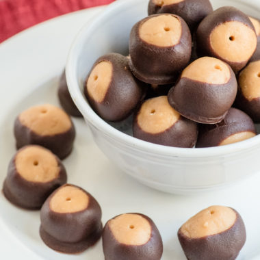paleo buckeyes cookies on white plate with red place napkin