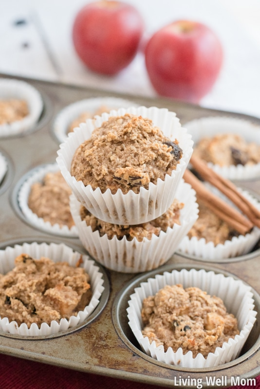 Gluten-Free Apple OatmNeed a satisfying healthy snack for the kids? Soft and delicious, bursting with apple flavor and sweetened only with honey and banana, this Gluten-Free Apple Oatmeal Muffins recipe is kid-approved and easy-to-make!