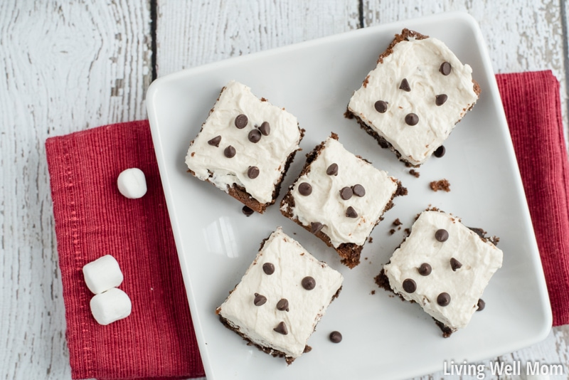 "Hot Cocoa Brownies are chewy and delicious with little bursts of chocolate chunks and a creamy ""marshmallow"" frosting. No one ever guesses this recipe is Paleo, gluten-free and dairy-free!"