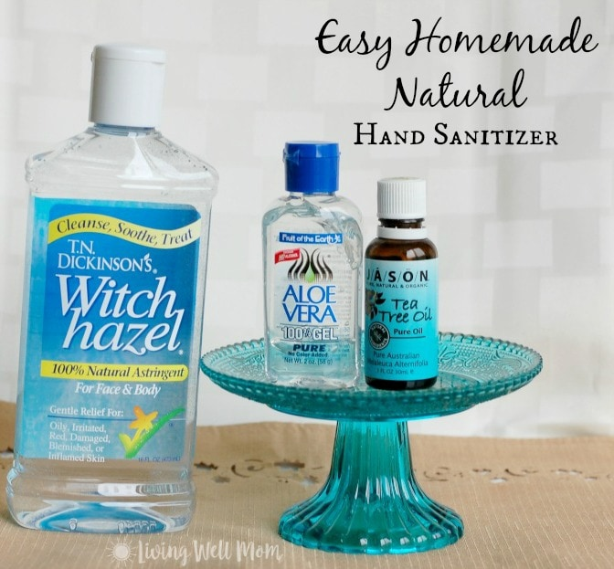 witch hazel, aloe vera gel, and tea tree oil on a stand
