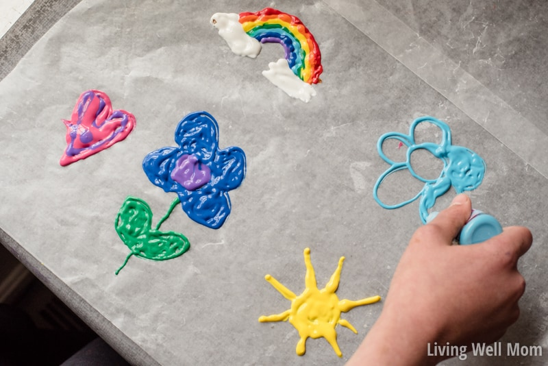 Why buy them when you can make them? This is the easiest way to make DIY Window Clings! Super easy, fun, and creative - kids of all ages will love making their very own window art! Find out how to do it here...